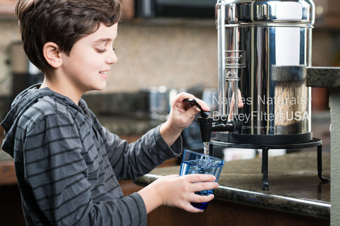 BerkeyFiltersUSA boy drinking water from berkey filter