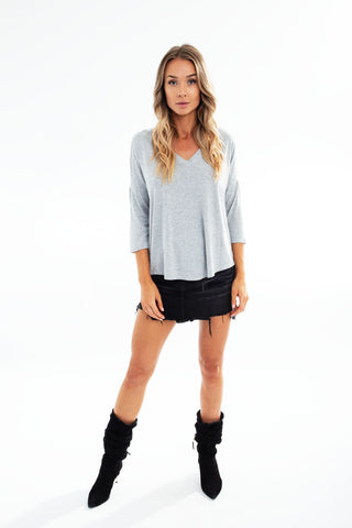PONCHO ASYMMETRICAL V-NECK TOP thin stripes