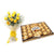 Flowery Celebrations- - This exciting combo of Flowers and Chocolates contains: 10 fresh Yellow Rose bunch One Ferrero Rocher 24 pcs While we always strive to ensure that products are accurately represented in our photographs, from season to season and subject to availability, our florists may be required to substitute one or more flowers for a variety of equal or greater quality, appearance and value.