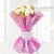 Charming Lady- - for Midnight Flower Delivery in India - This beautiful bunch consist of: 12 White Roses Fresh green and white fillers Pink cellophane paper wrap White ribbon bow