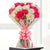 Red n white beauty- - for Online Flower Delivery In India - This beautiful bunch consists of: 12 red and white carnations Cellophane paper wrap Pink ribbon bow Green fillers