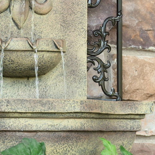 Outdoor French Lily Electric Wall Fountain in Florentine Stone Finish