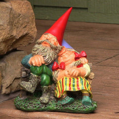 Man And Woman Garden Gnome Relaxing On Bench