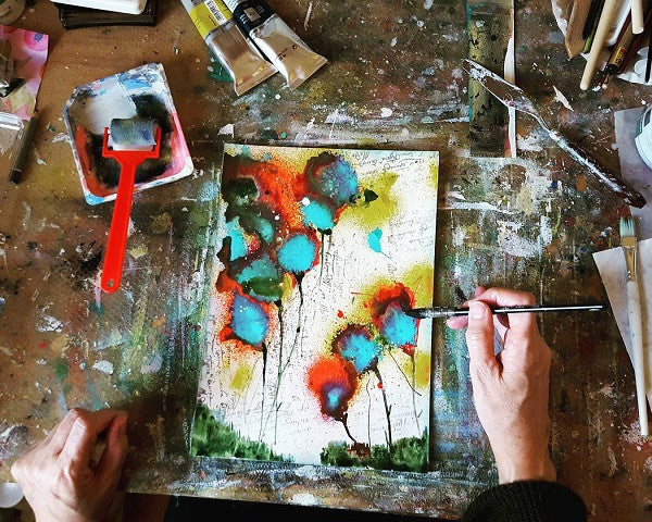 Artist Christine Eder is in the process of creating a stunning painting.
