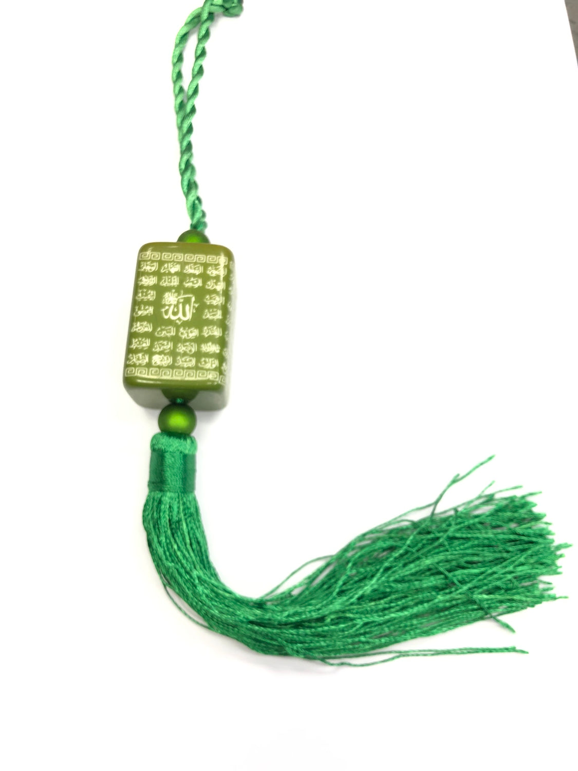 green ornament with names of allah