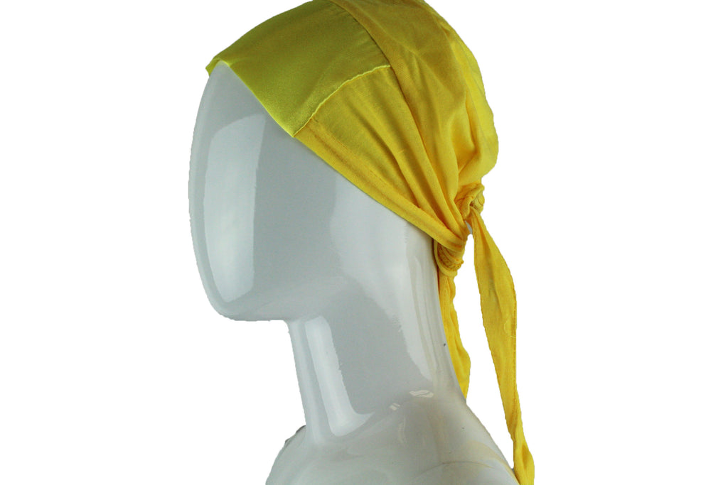 yellow tie back under cap with a satin trim