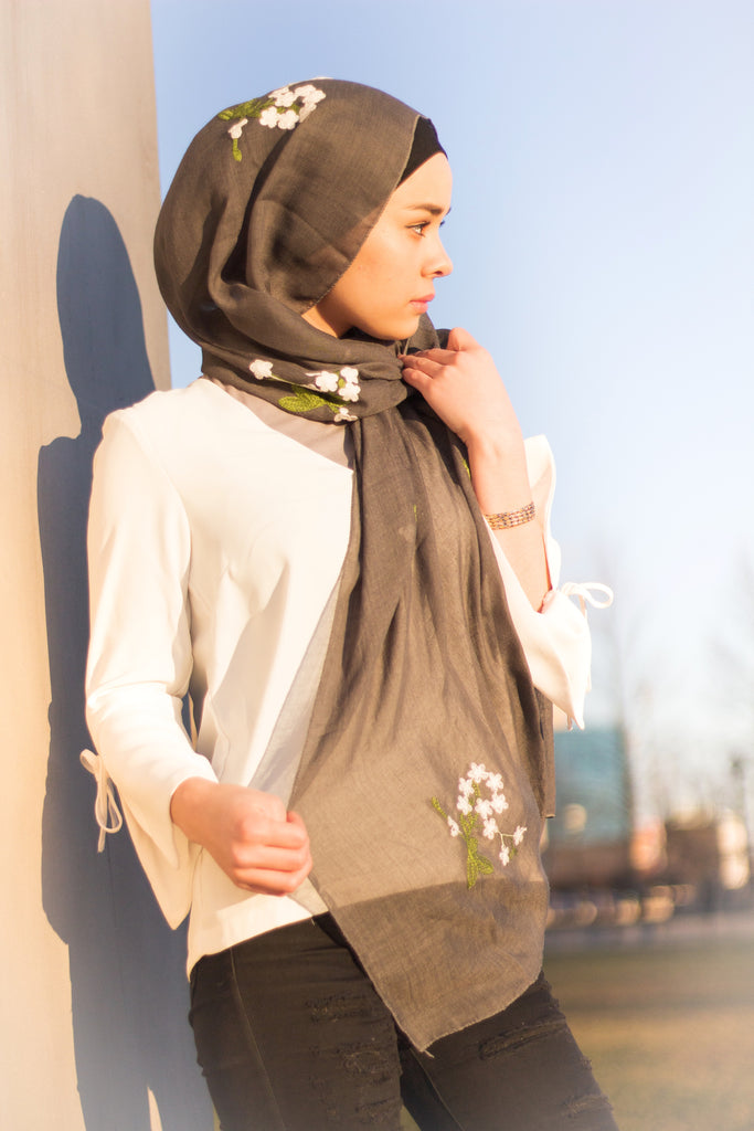 muslim woman wearing a dark gray floral embroidered hijab