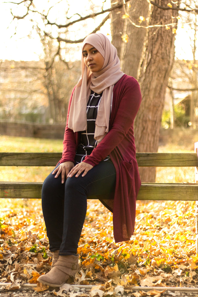 a hijabi wearing a modest cardigan with pockets, grid top, and chiffon hijab from bella hijabs