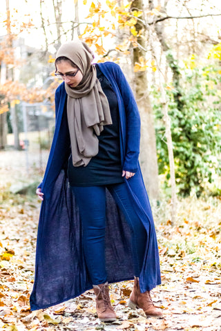 a hijabi wearing a modest maxi cardigan with pockets and chiffon hijab from bella hijabs