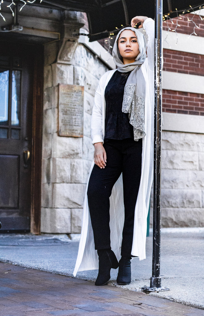 white maxi cardigan with long sleeves and pockets