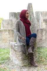 a hijabi wearing a modest cardigan with pockets and chiffon hijab from bella hijabs