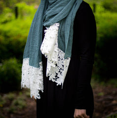 emerald green viscose hijab with white embroidery lace on the ends