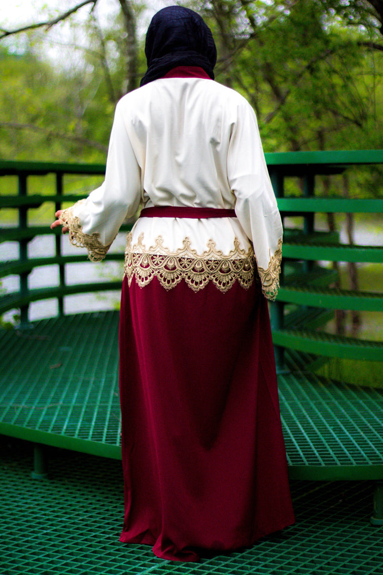 creme and maroon two toned abaya with gold trim and waist tie