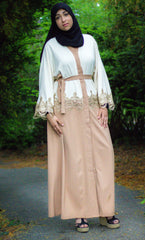 creme and tan two toned abaya with gold trim and waist tie