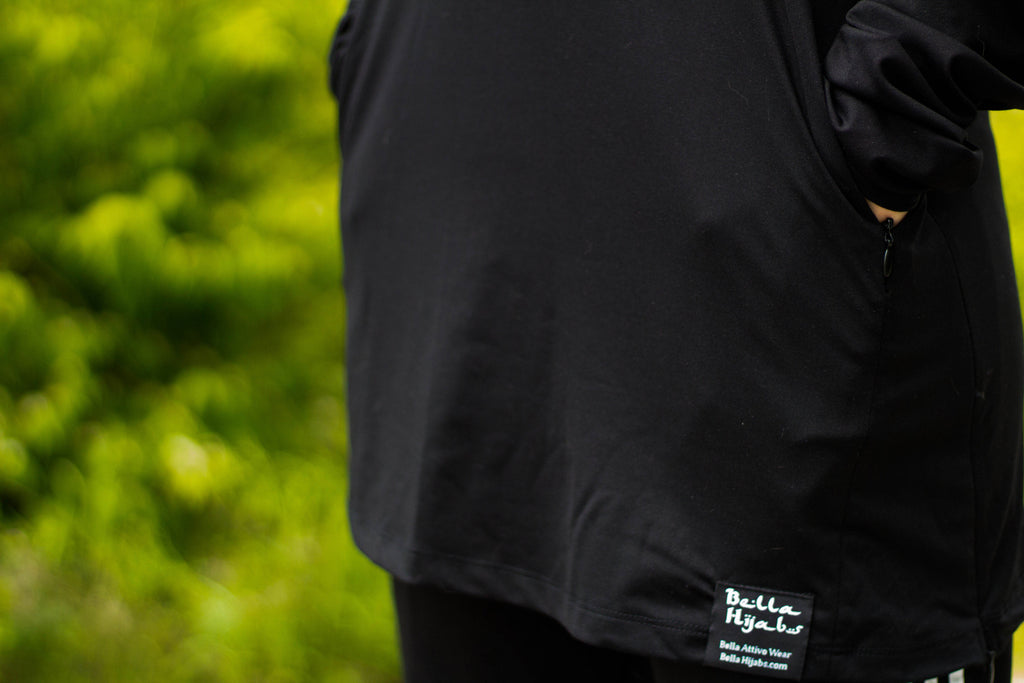 pockets on a black long sleeve workout top