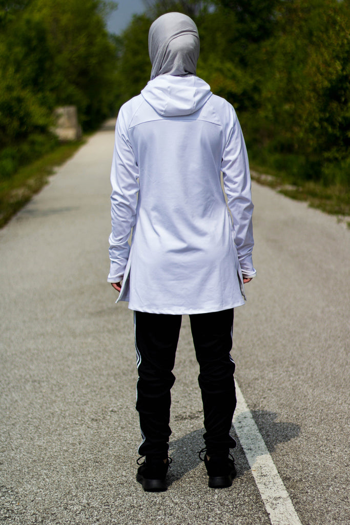 white workout top with long sleeves and a hijab attached with a gray jersey hijab