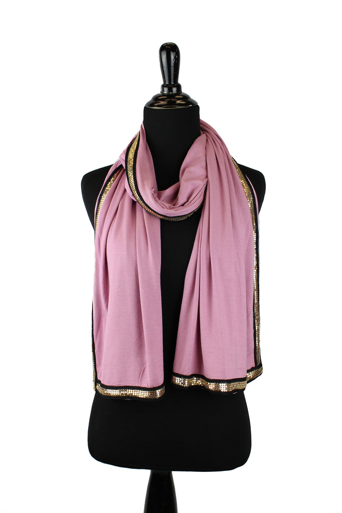 blush jersey hijab embellished with a gold trim along the edges