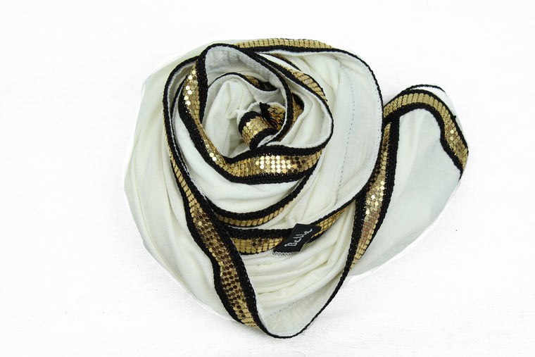 white jersey hijab embellished with a gold trim along the edges
