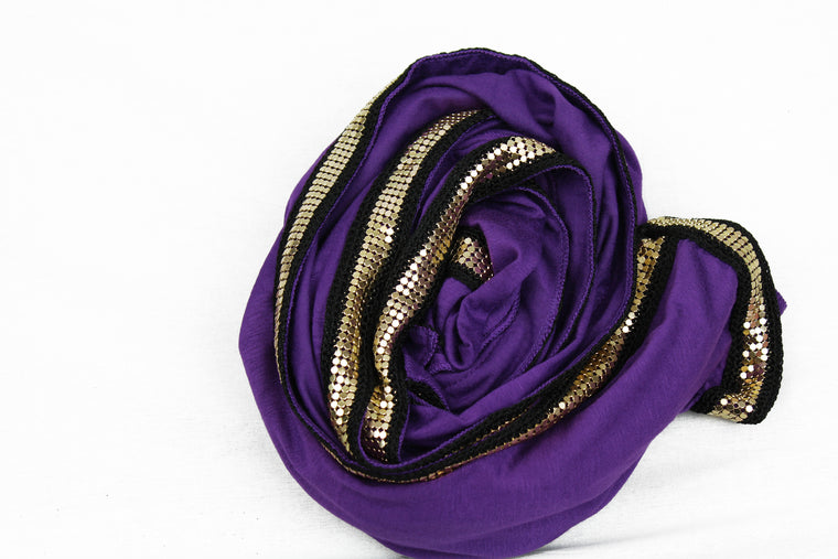 purple jersey hijab embellished with a gold trim along the edges