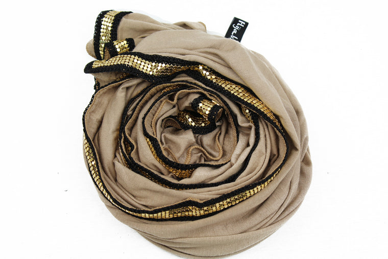 taupe jersey hijab embellished with a gold trim along the edges