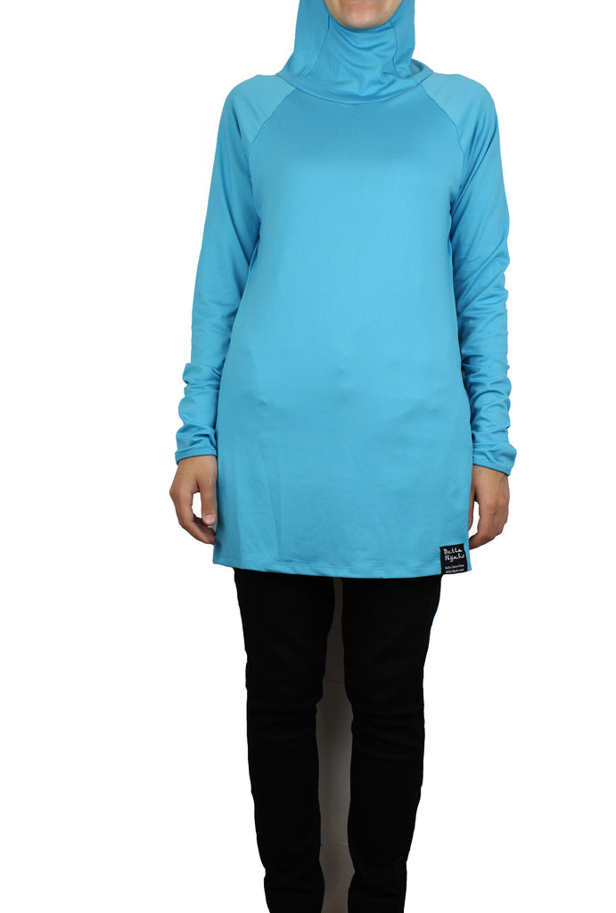 cyan blue long sleeved workout top with a hijab attached on a muslim model