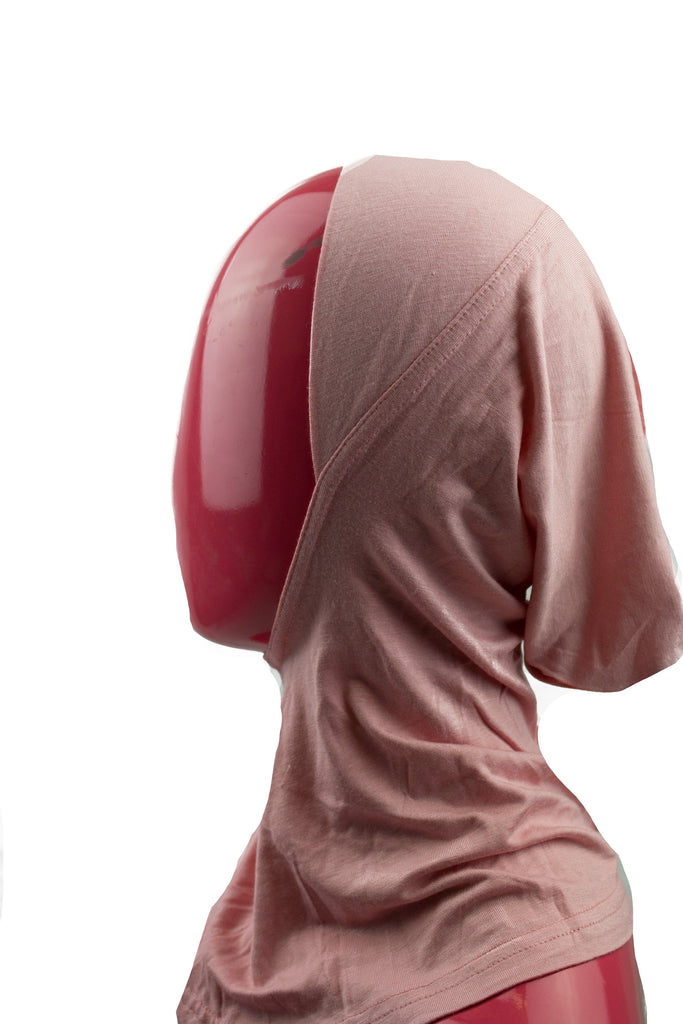 light pink ninja underscarf worn under the hijab to cover the hair and neck