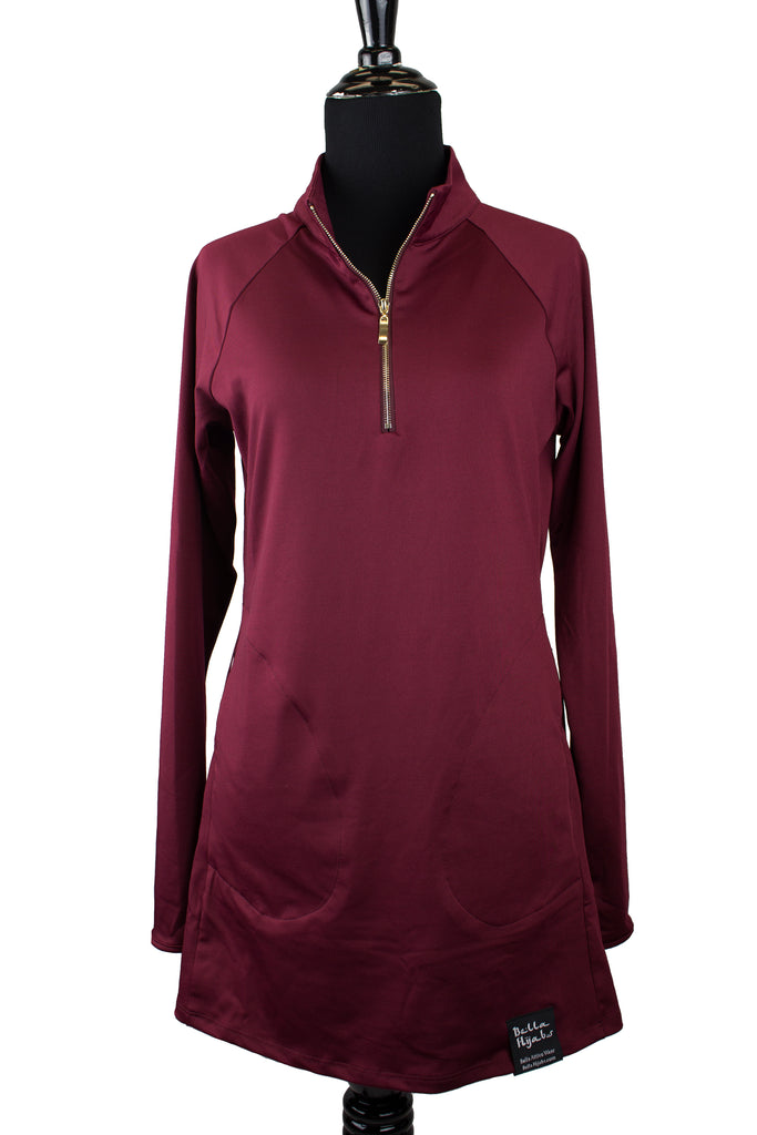 long sleeved workout top in maroon with a gold zipper