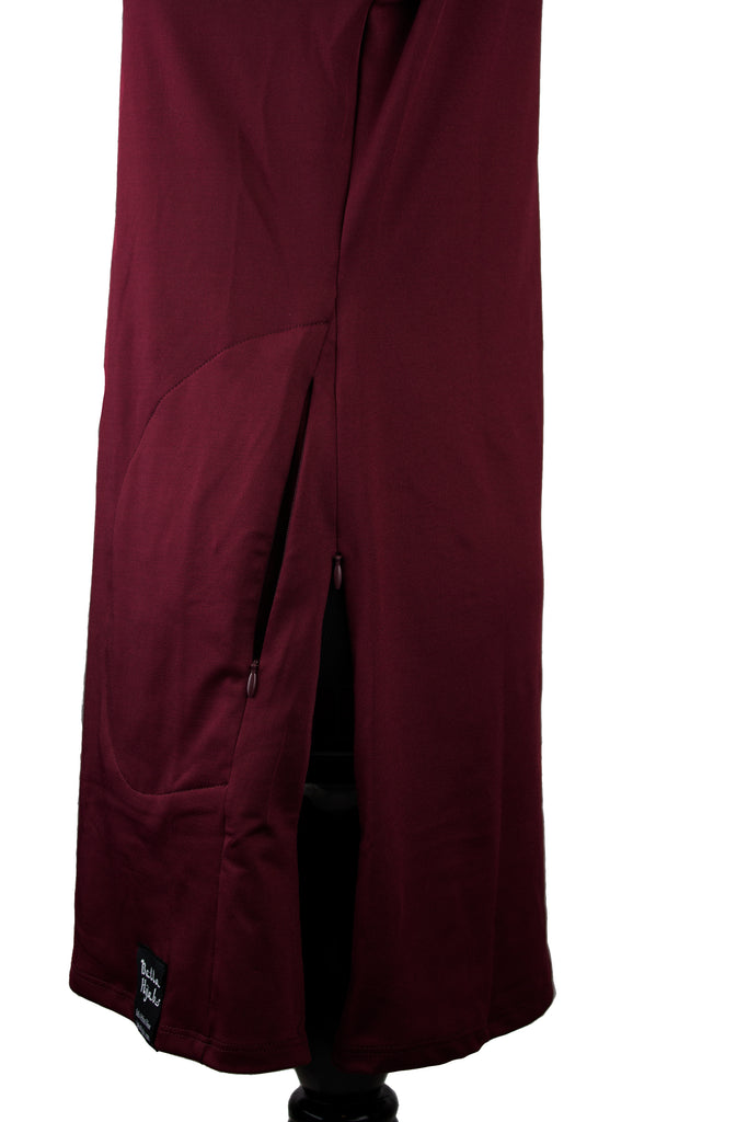 side zippers on a maroon long sleeve work out top