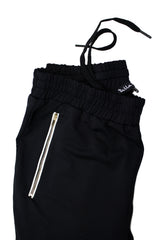 black jogger pants with gold zippers and drawstrings