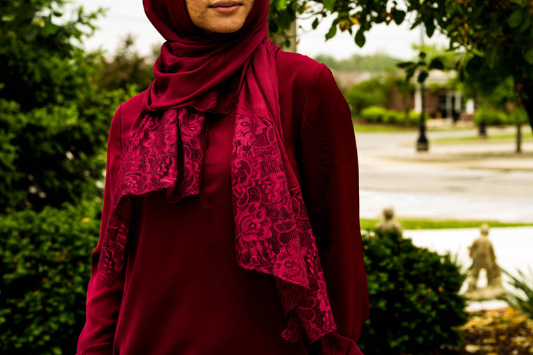 solid burgundy hijab made with modal fabric and embellished with lace at the ends