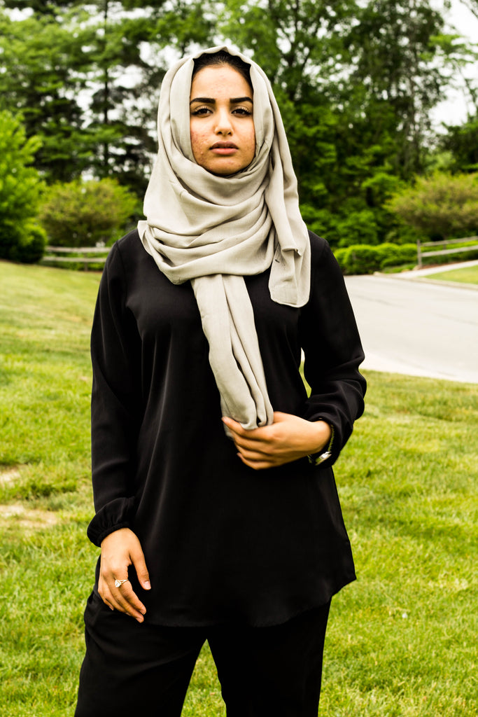 a muslim woman wearing all black and a bamboo hijab in gray