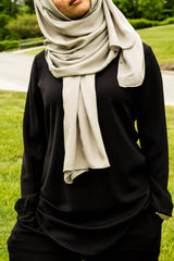 a woman wearing all black and a gray bamboo hijab