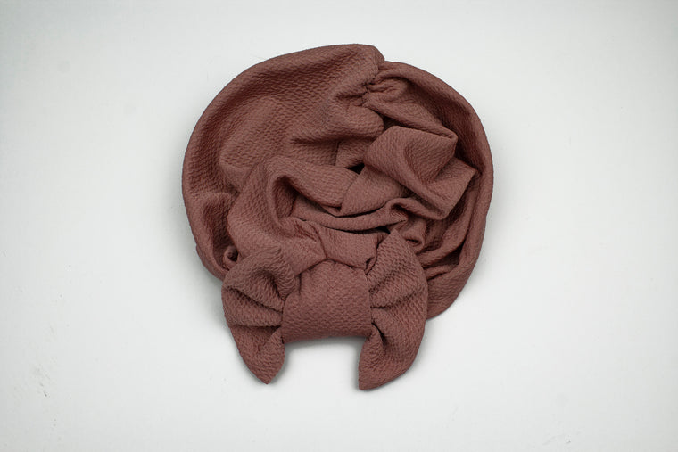 pink slip on turban with a large bow on the front