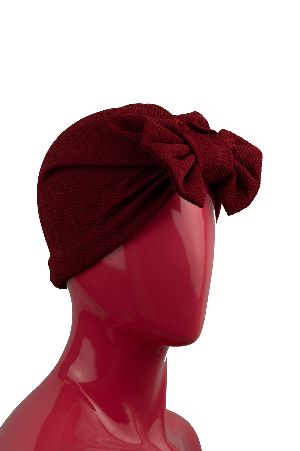 maroon slip on turban with a large bow on the front