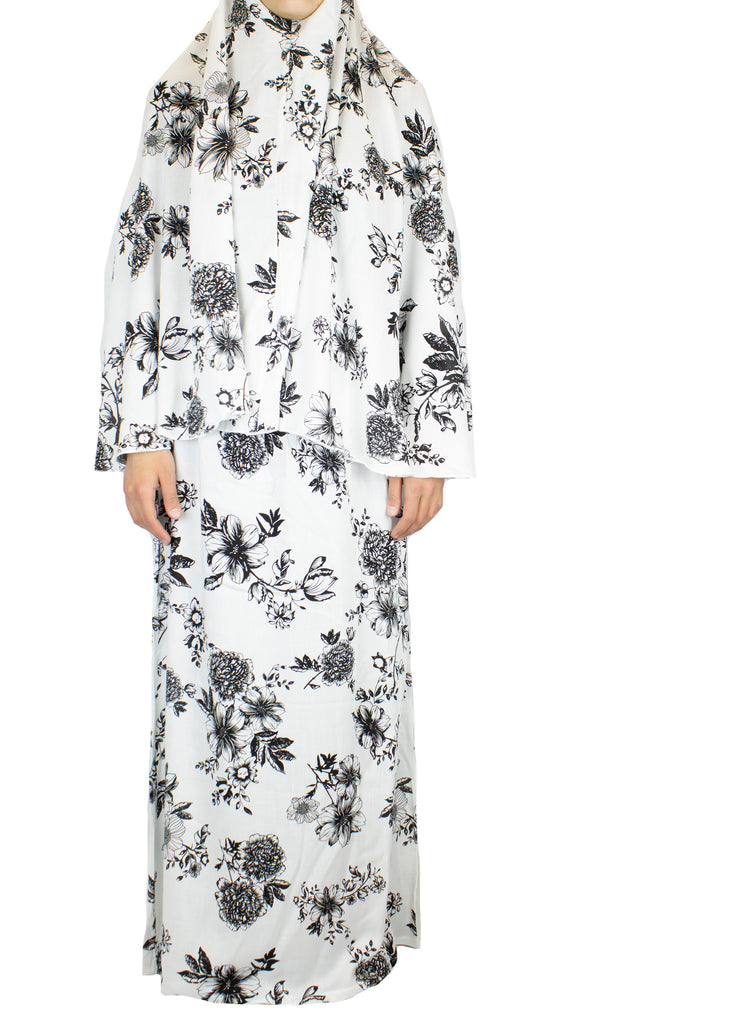 two piece salah outfit with hijab and skirt printed with black and white floral