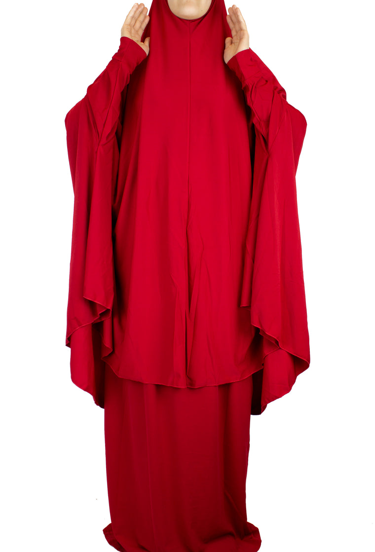 red two piece prayer set with a long khimar that covers to the knees and a maxi skirt