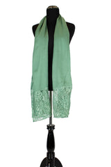 solid light green hijab made with modal fabric and embellished with lace at the ends
