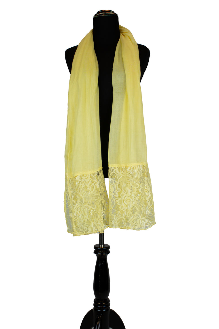 solid light yellow hijab made with modal fabric and embellished with lace at the ends