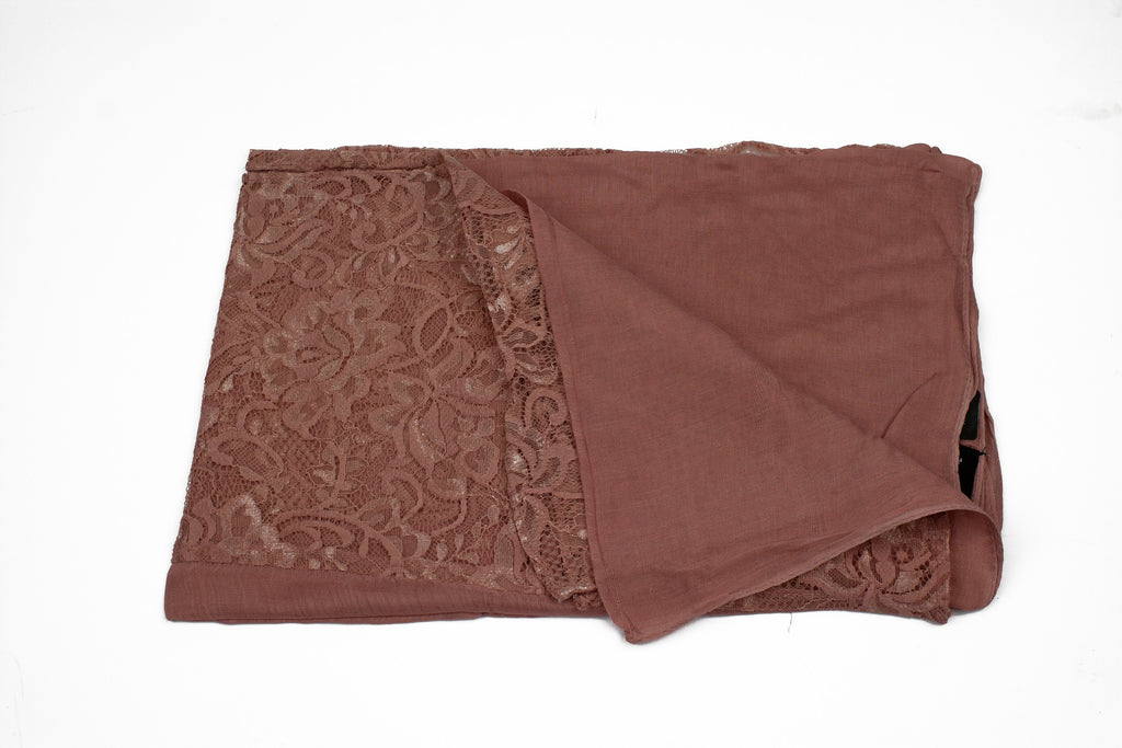 solid mauve hijab made with modal fabric and embellished with lace at the ends
