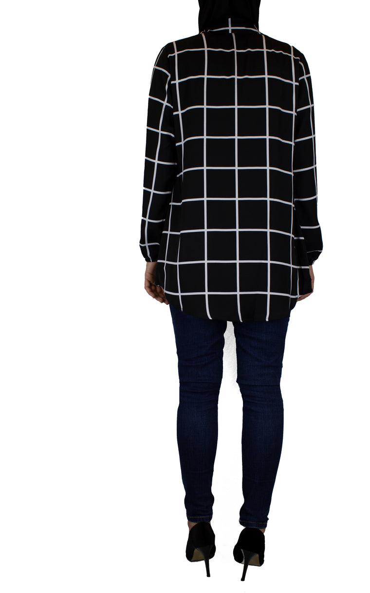 sleeve with stretchy wrist on black and white grid shirt
