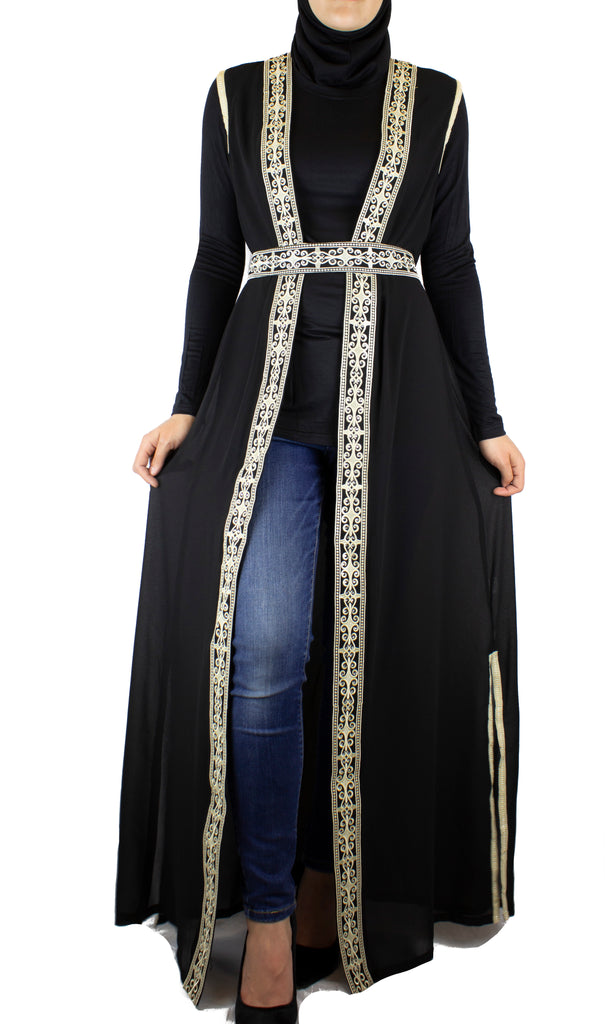 black sleeveless duster with palestinian inspired embroidered detailing and a matching belt