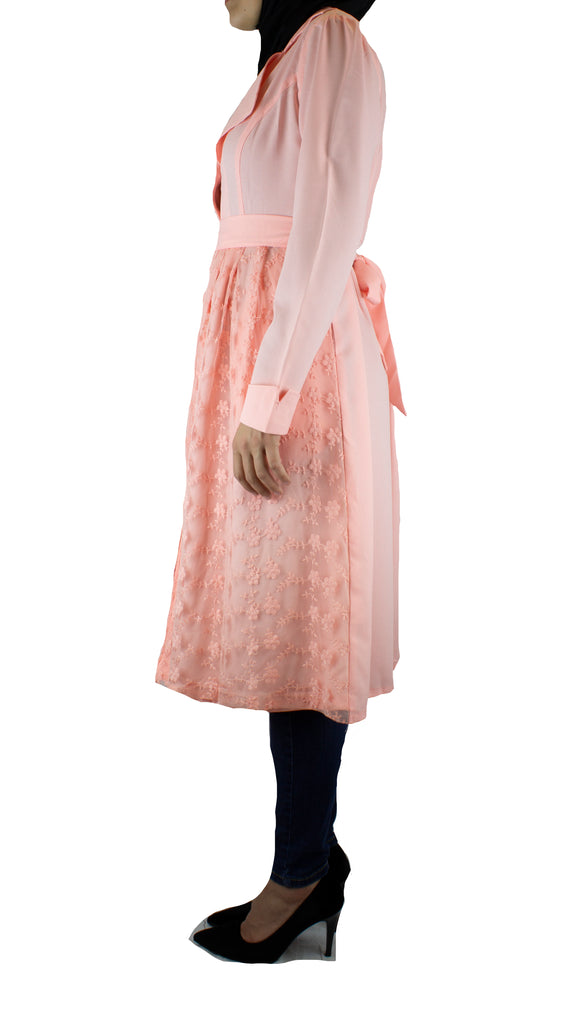 light pink long sleeved cardigan embellished with creme lace with pockets and a waist tie