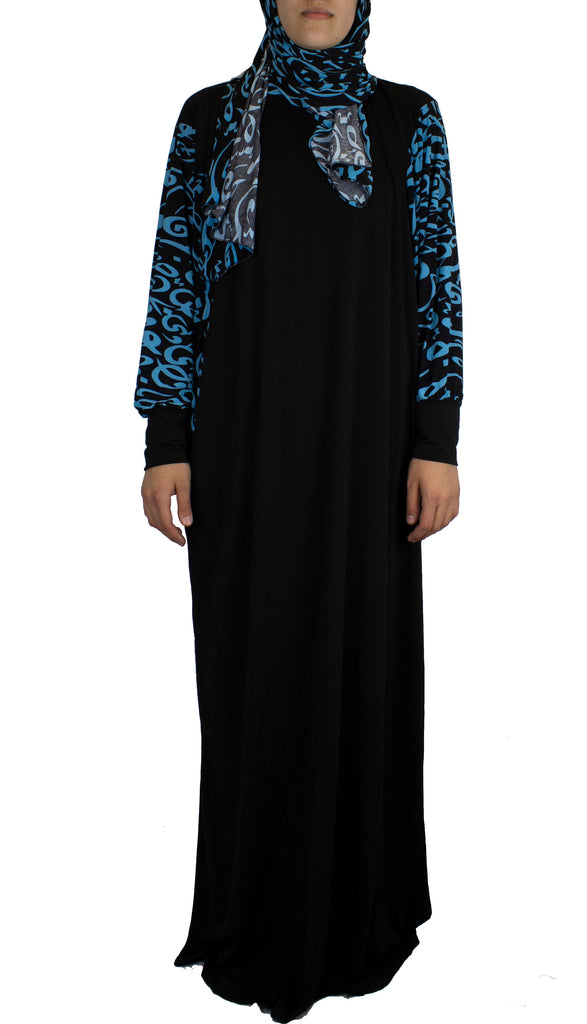 black and blue one piece abaya with arabic calligraphy detailing and a hijab attached
