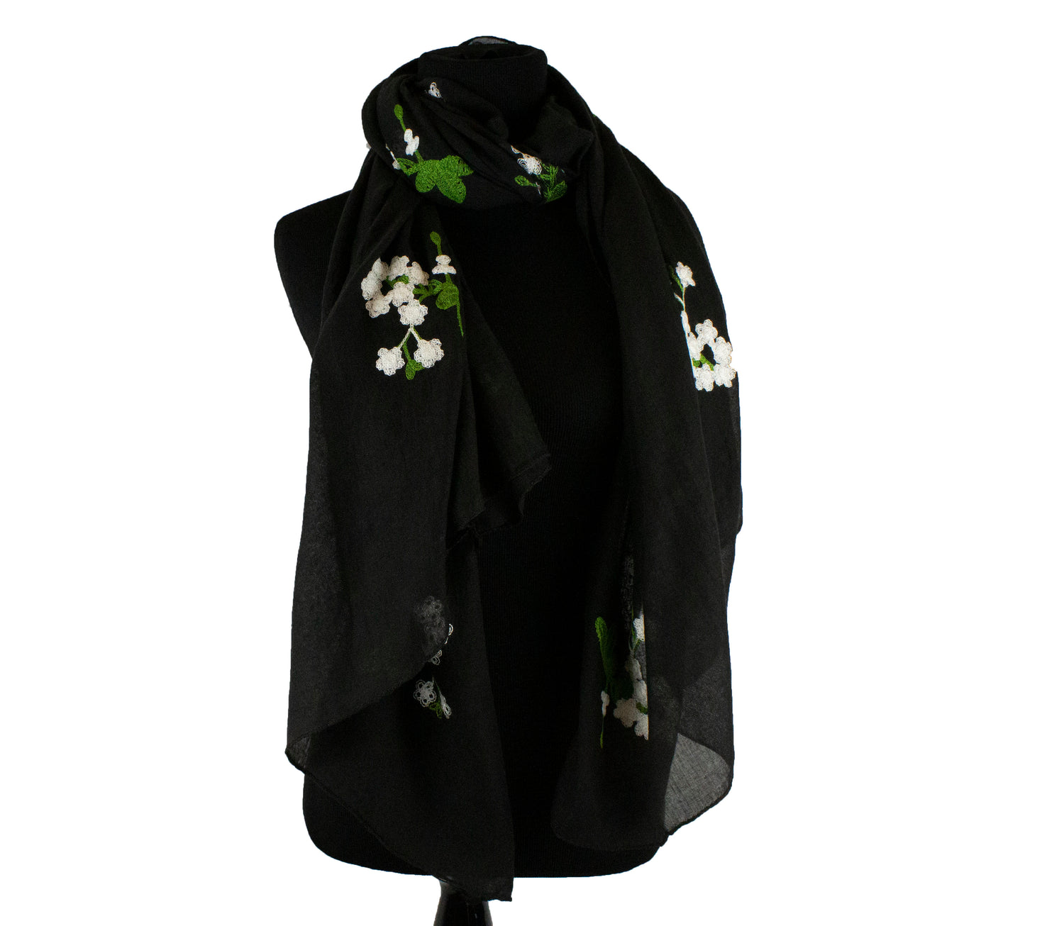 black hijab with white embroidered flowers and green details