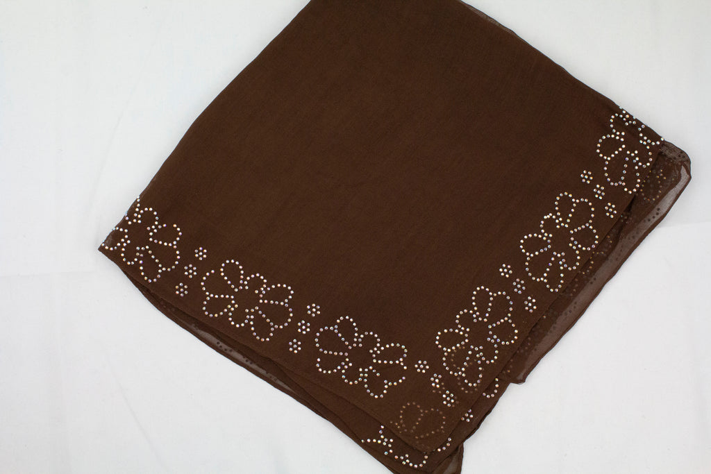 brown square hijab with jewels along the edges in a floral pattern