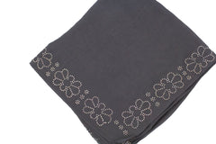 dark gray square hijab with jewels along the trim in a floral and geometric pattern