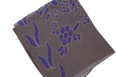 gray square hijab embellished with blue jewels in a floral pattern