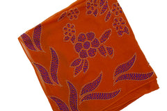 orange square hijab with blue jewels in a floral pattern