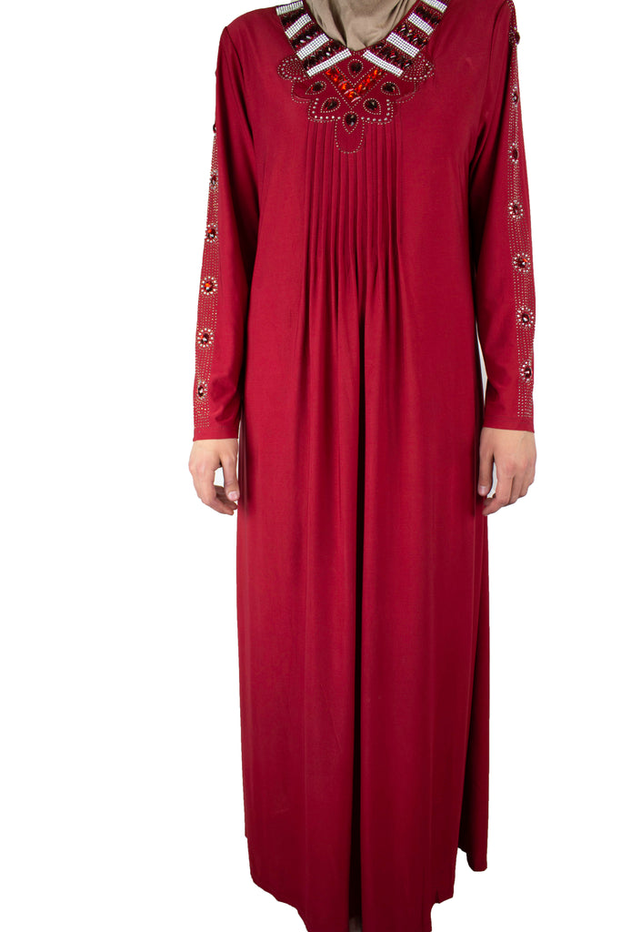 maroon abaya with pleats on the chest and jewels along the neckline and arms
