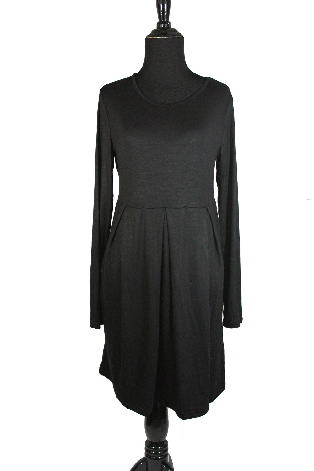 black long sleeved midi top with an aline and pleats